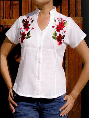 This Yucatecan blouse is the women's guayabera style with colorful hand embroidered flowers. The design is simple with a modern cut. The embroidery is still very much Mayan