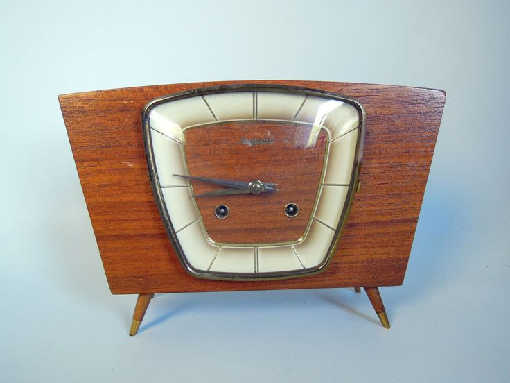 clocks that stop time on pinterest mid century modern wall clocks