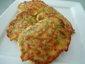 Zucchini pancakes. Recipe by Ina Garten: http://www.foodnetwork.com/recipes/ina-garten/zucchini-pancakes-recipe/index.html