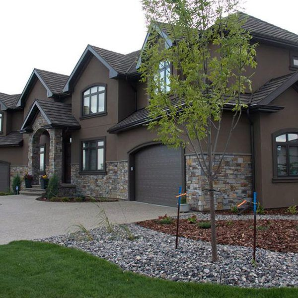 Exterior home photos beauteous traditional exterior home for Stucco stone exterior designs