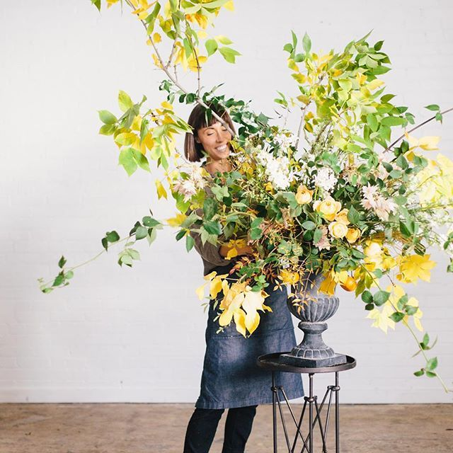 """Photo by @kateosborne from a recent 1:1 lesson. My lecture on large arrangements always begins with """"find a good overgrown spot on the side of the road, and cut branches the size of a small tree down."""" #sarahwinwardclasses #sarahwinwardflowers"""