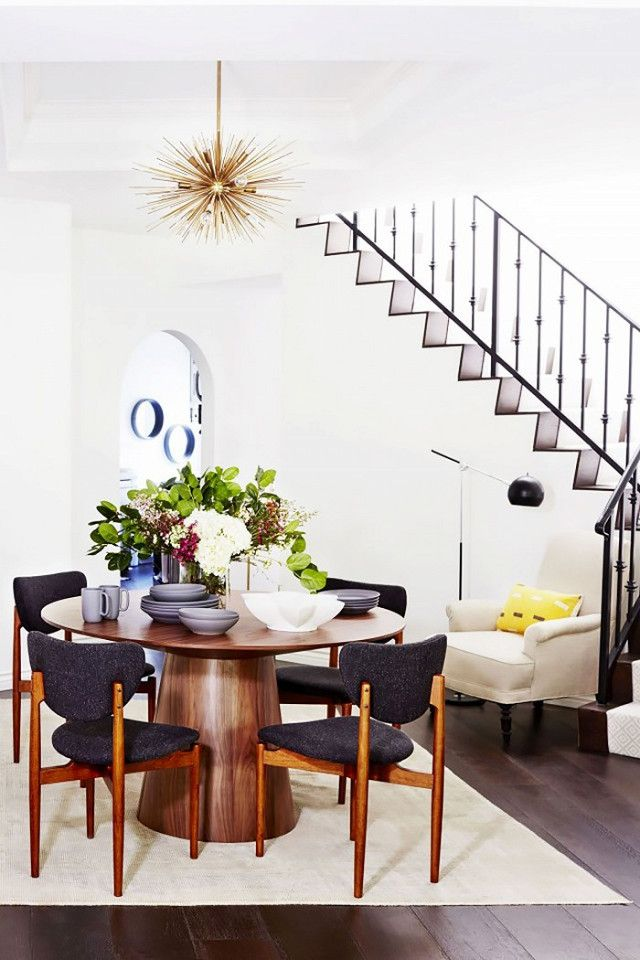 chic dining room design featuring a gold sunburst statement chandelier midcentury modern chairs and table