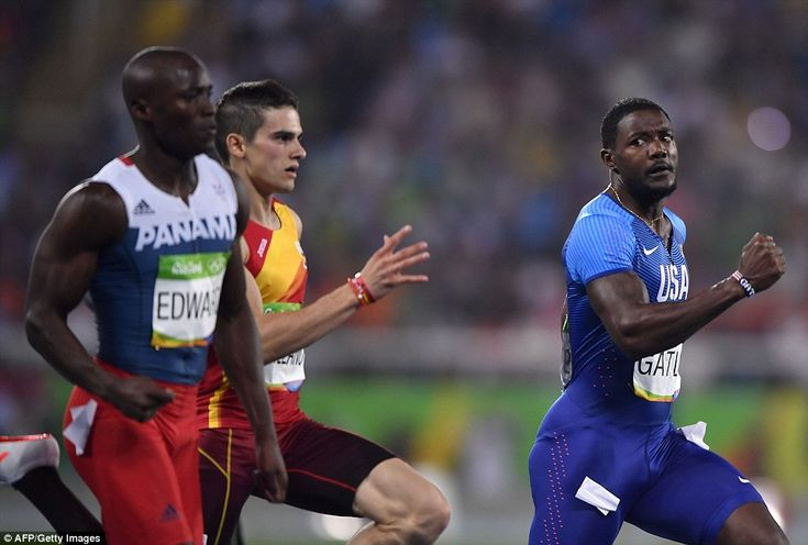 Gatlin (right) missed out after  Churandy Martina and Alonso Edward (left) finished ahead ...