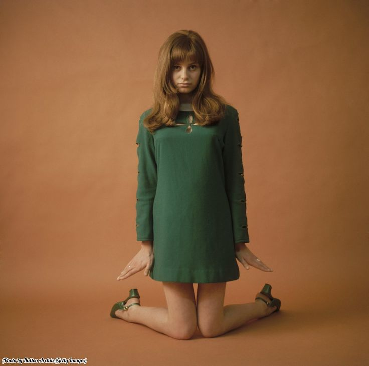 The epitome of 1960s fashion. British actress Susan George in a mini-dress with matching green shoes, 1965.