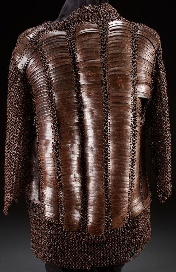 Russian behter armor , 17th c, the chest, back, sides and shoulders with overlapping rectangular curved iron plates linked to a riveted mail vest with three quarter length sleeves and waist. Overall length 29.25 inches (74.2 cm). Some comparable examples are illustrated in Leonid Tarassuk, 'The Collection of Arms and Armour in the State Hermitage, Leningrad', The Journal of the Arms and Armour Society, Vol. V, Nos. 4-5, March 1966, pp205-208. Back view.