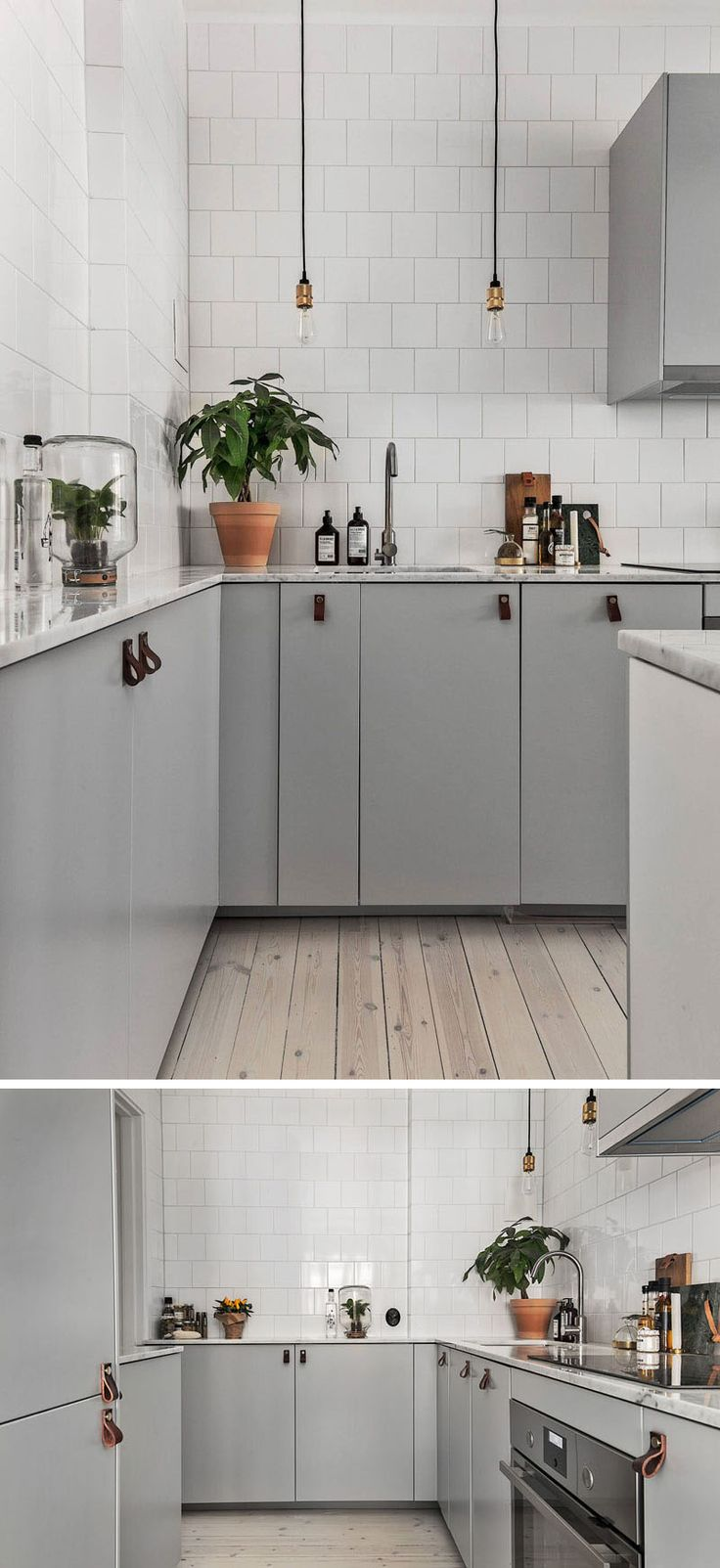 12 Examples Of Sophisticated Gray Kitchen Cabinets // Minimalist gray cabinets have been paired with white tiles and leather pulls in this kitchen.