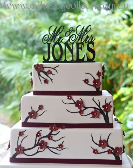 3 Tier square wedding cake with cherry blossom flowers & hand painted tree detail.