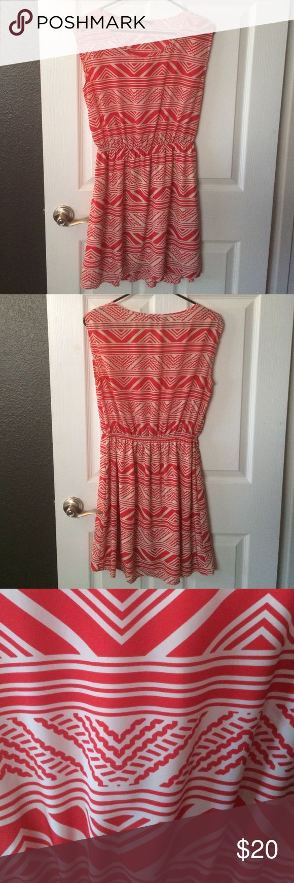 Tribal orange and cream dress Worn only a few times orange and cream sleeveless dress. Knee length. Very lightweight. Peach love cream Dresses Midi