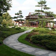 Jardines de estilo asiático de Kirchner Garten + Teich GmbH