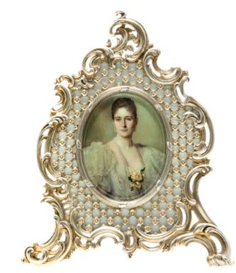 A Fabergé Silver and Enamel Frame, Workmaster Julius Rappoport, St. Petersburg, circa 1900, in Rococo taste, of cartouche form, the surface of translucent oyster enamel on an engine-turned ground, overlaid with flower-set trellis within bold rocaille scrolls, the oval aperture within a leaf-bound reeded bezel.