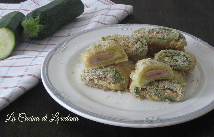 I Bocconcini di Zucchine al forno farciti con mozzarella filante e prosciutto per un contorno delizioso che conquista subito tutti