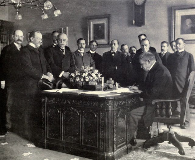 Jules Cambon, the French Ambassador to the United States, signing the memorandum of ratification on behalf of Spain in 1899. Source: Wikipedia/Public Domain