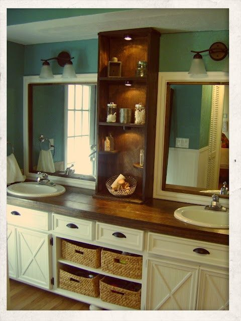 Shelves with baskets in the middle and the builder grade mirror framed with the added bookcase make a nice addition to this master bath DIY project.