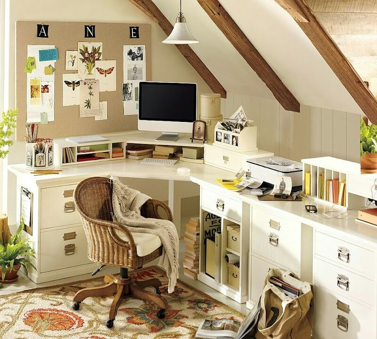 Craft room idea for the upstairs bonus room with desk tucked under a slanted ceiling.