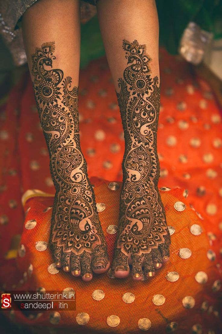 The bride's feet covered in flawless mehendi design.