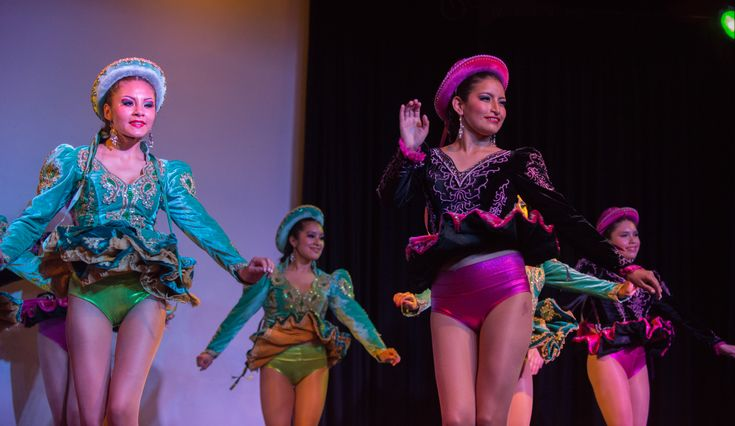 OH MY! YES! Beautiful Bolivian babes perform a traditional Caporales dance routine on stage! Love how their undies match the trim on their costumes! Perfect timing for that one sweetie - her big, shiny purple panties are completely exposed!!