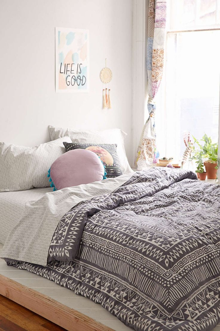 I want this room! Love the bedsheets and pillows! It just ties the whole room together!