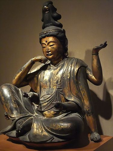 Buddhist bodhisattva of compassion Nyoirin Kannon Japan Kamakura period 1250-1330 CE Wood with lacquer and gilding