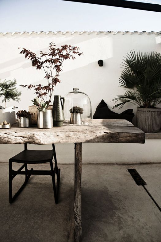 White stucco walls and natural wood table