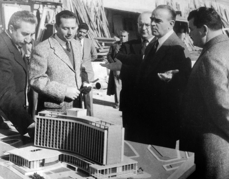 1959 - Ex-Prime Minister Konstantinos Karamanlis examines the mock-up of the hotel. With him is the later President of the Republic, Μr Konstantinos Tsatsos, ex-Minister Mr Emmanuel Kefalogiannis and architects Mr Antonis Georgiadis and Mr Spiros Staikos.