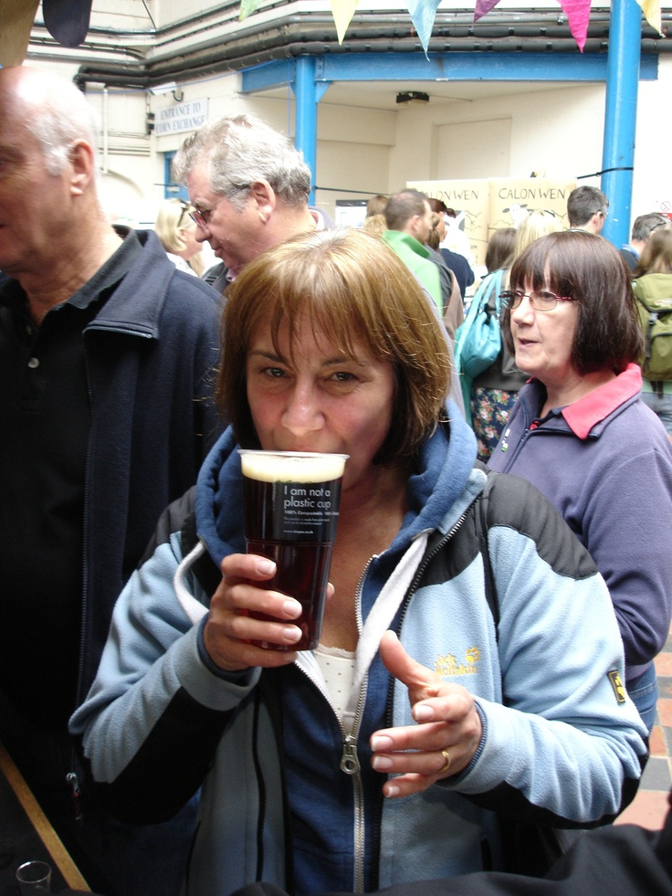 Customer drinking out of Biopac's eco friendly 'I am not a plastic cup' PLA tumbler at the Abergavenny Food Festival.