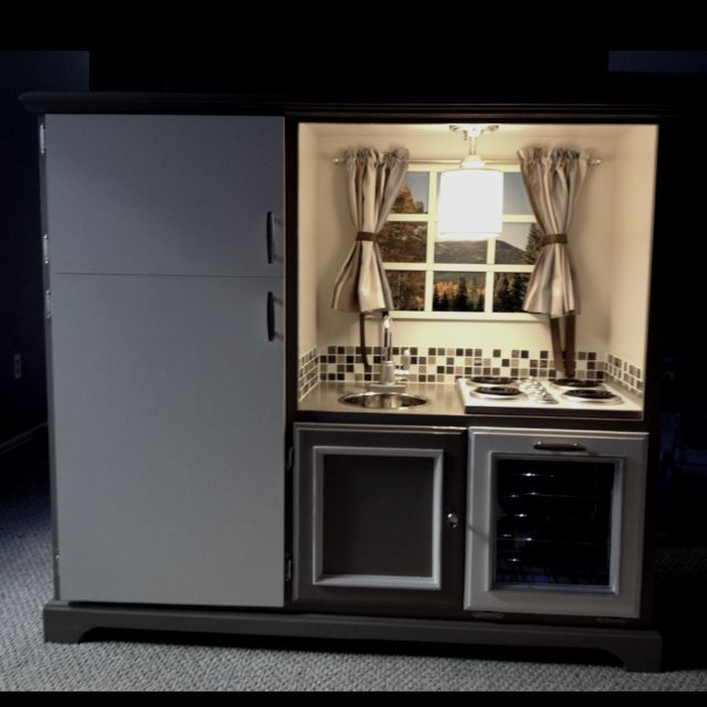 Love the light idea! Play kitchen from a tv stand. Complete with oven, stove, refrigerator, sink, light and mountain view : )