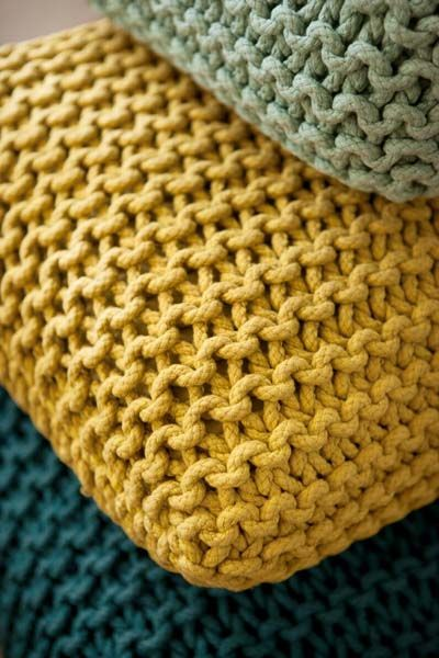 Anything crocheted and knitted floor rugs, to poufs, to baskets and pillows I love. They are definitely comfortable and warm. Its a very modern look to add to a living space. Great cool colors!