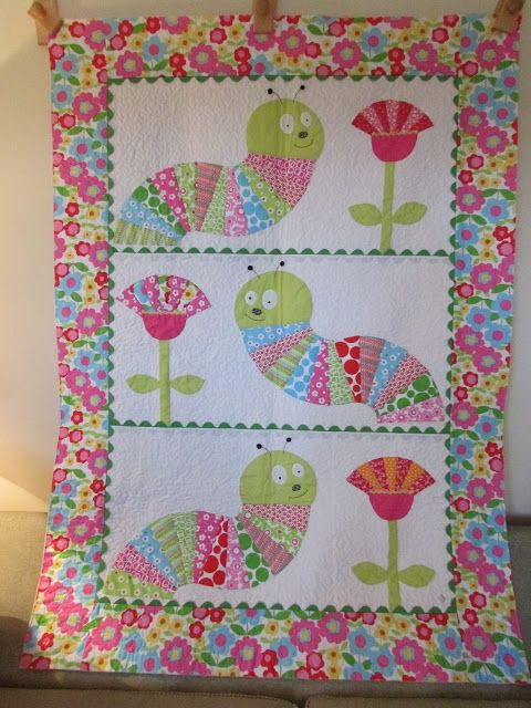 caterpillar quilt using the Dresden Plate ruler Cute for a baby gift. Photo inspiration.