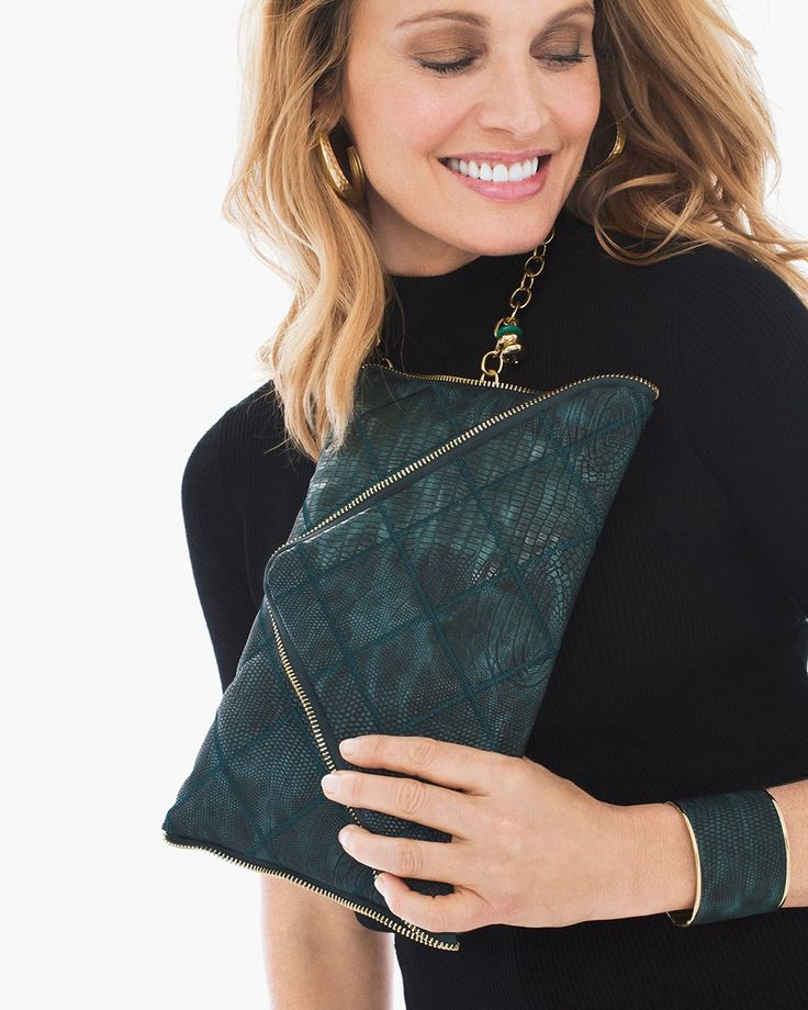 Life's a wild adventure— accessorize accordingly. Loving this faux-snakeskin clutch and matching cuff.