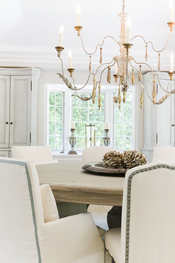 dining room // upholstered chair details #nailhead #slipcovered