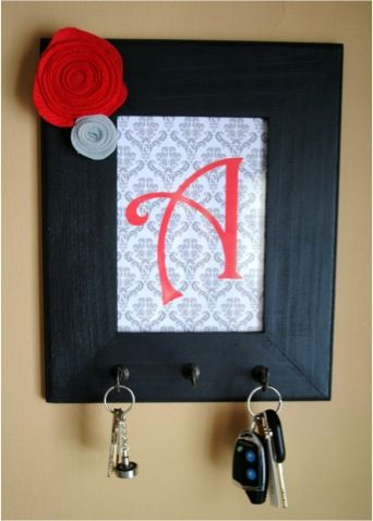 Frame Key holder,,,, this would be adorable in a kitchen with aprons on it!!!!! TOO STINKIN' CUTE!!!! I'm definitely making one of these!!!!!