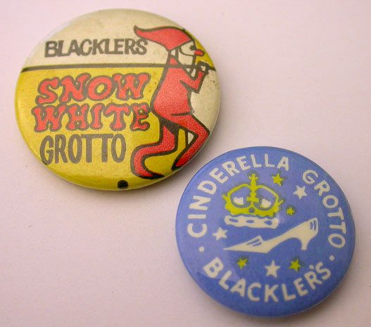 old badges with a Christmas elf and Cinderella's glass slipper