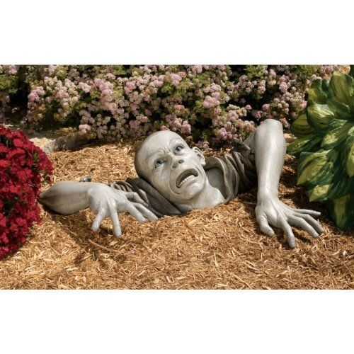 The Zombie of Montclaire Moors Sculpture by Design Toscano. $99.95. Design Toscano exclusive. Hand painted. Made for indoors or outdoors. Cast in quality designer resin. Capturing a truly haunting occurrence, our flesh-hungry zombie will claw his way out of your garden plot or family room corner to startle passersby! We challenged our artist to create his most macabre zombie statue exclusively for Design Toscano, and he certainly delivered. Not for the faint of heart,...