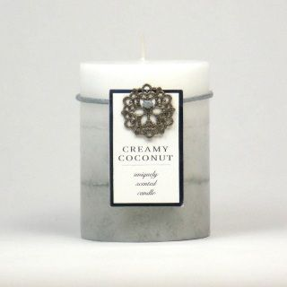 "by Smart Living Company Let your mind drift off to a tropical vacation when the fragrance of this scented candle fills your space. Smooth notes of coconut cream are sweetened by vanilla and white sugar; and enhanced by tropical hints of pineapple and orange. Lead and tin free cotton wick. Burn Time: 60 Hours. 3"" x 3"" x 4"" 