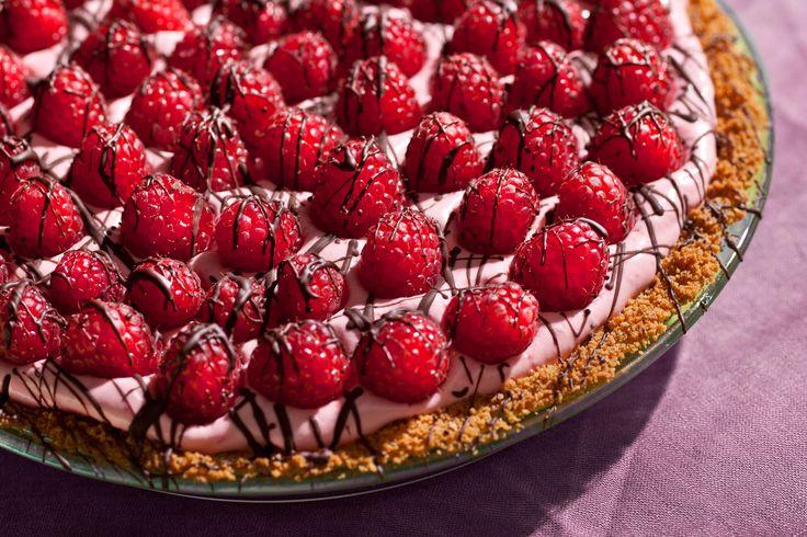 This chocolate-raspberry cream pie recipe has a graham cracker crust covered with chocolate, filled with raspberry cream, and topped with fresh raspberries.