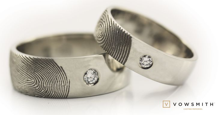 Personnalized fingerprint wedding bands 14k white gold and quite nice diamonds too!