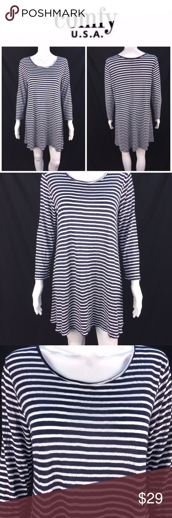 "Comfy USA Sz L Navy & White Striped Tunic Top *  Comfy USA Sz L Navy & White Striped Tunic Top Sharkbite Hem Cozy Lagenlook * Please see below for measurements; all measurements taken with garment lying flat.  Please see all photos for complete condition assessment. Shoulder to Shoulder: 17"" Armpit to Armpit (Bust): 22"" Waist: NA"" Overall Length: 28/32"" Sleeve: 24"" Item Number: 3056 K Comfy USA Tops Tunics"