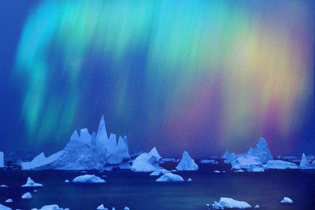 Aurora Australis over icebergs.