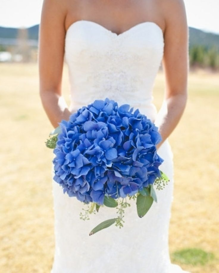 """Bright blue hydrangeas for your """"something blue"""" (Photo by: Brian Kraft on Southern Weddings via Lover.ly)"""