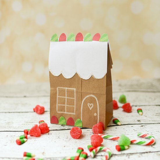 Turn a brown paper lunch bag into a cute gingerbread house package, perfect for packaging cookies for neighbor gifts.
