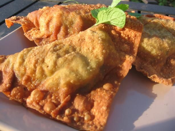 Sambossa (Ethiopian Appetizer) from Food.com:   This is a wonderful little Ethiopian snack that is quite similar to a samosa. You skip making the dough by using wonton wrappers. Enjoy!