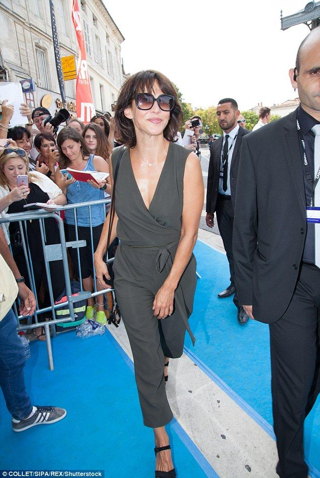 If you wear perfume, give your clothes a spritz rather than your neck or cleavage (Sophie Marceau, above)
