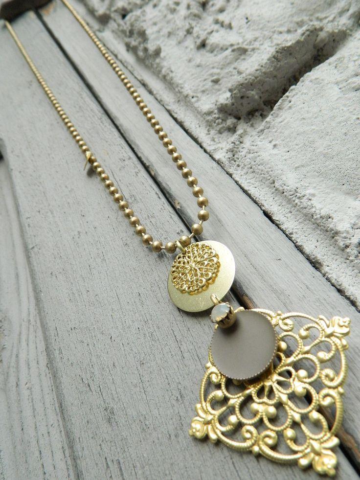 Natanè Planet Rhombus necklace on an old door. #necklace #collane #colors #beige #woman #fashion #style #outfit #swarovski #jewel #bijoux #door #porta #gate #girl #natanè