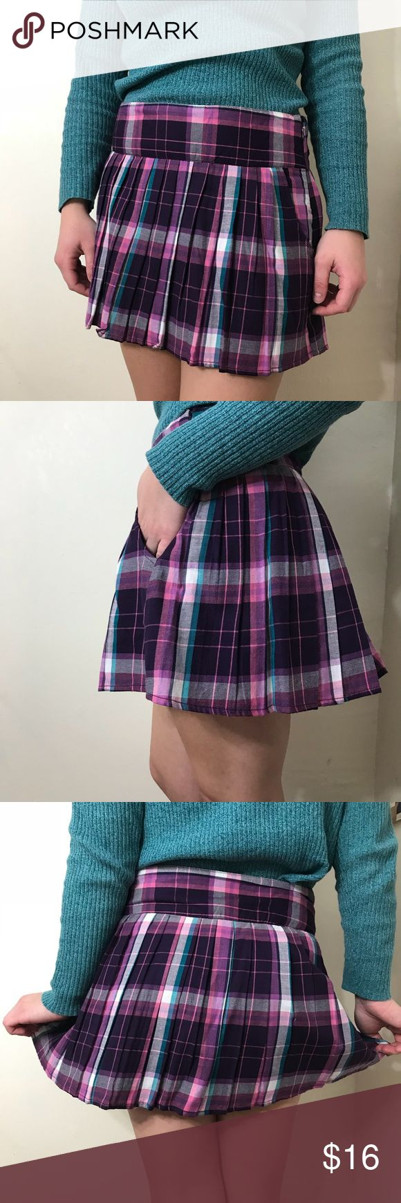 Purple plaid Aeropostale skirt Super cute purple skirt! Only worn once, in perfect condition. There is a clasp at the top of the zipper (pictured) that is held with string, this is how it was in the store Aeropostale Skirts Mini