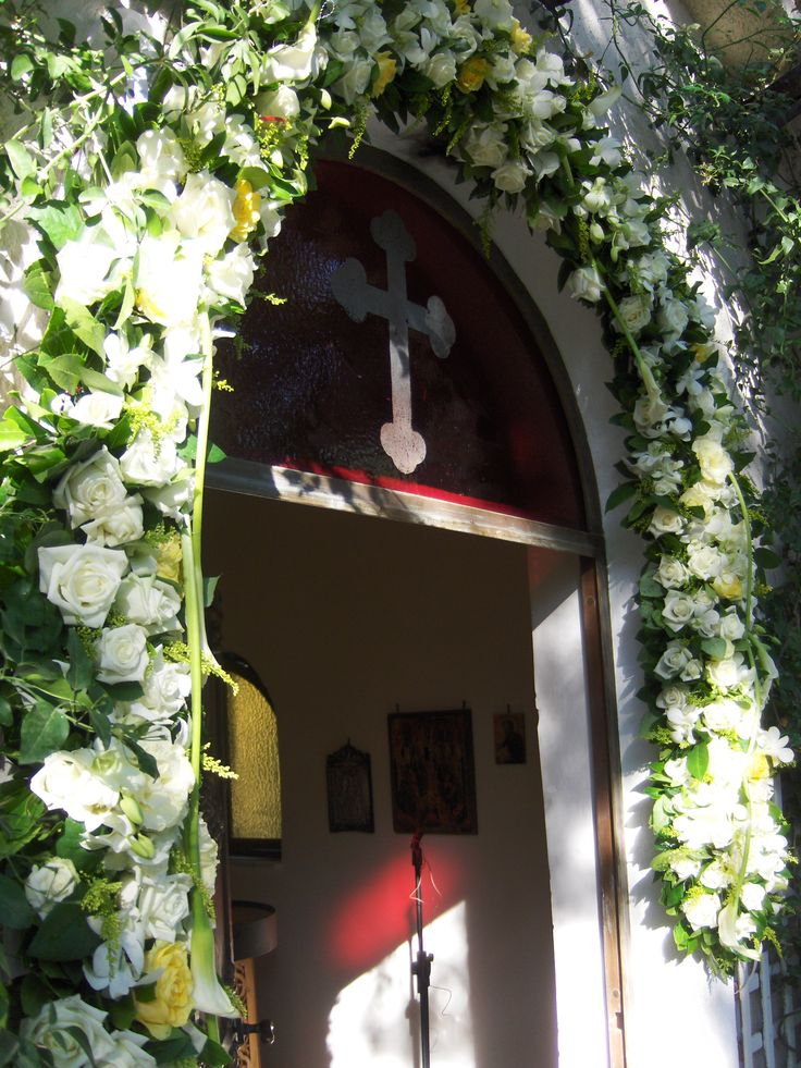 outdoor garland for a nice church  with white callas ,hydragenea and roses by flowers papadakis