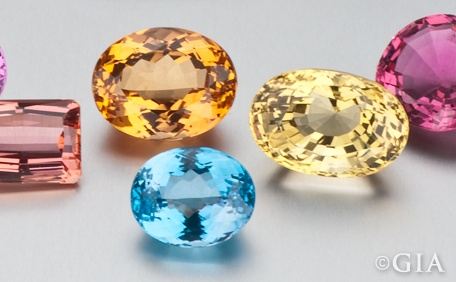 Topaz is often confused with citrine and smoky quartz. Topaz has an exceptionally wide color range which includes various tones and saturations of blue, green, yellow, orange, red, pink and purple as well as colorless. I especially love the blue ones and often use the White ones in my tiaras. Note the incredible many-faceted cut of the blue topaz here - it's calles a portuguese cut.