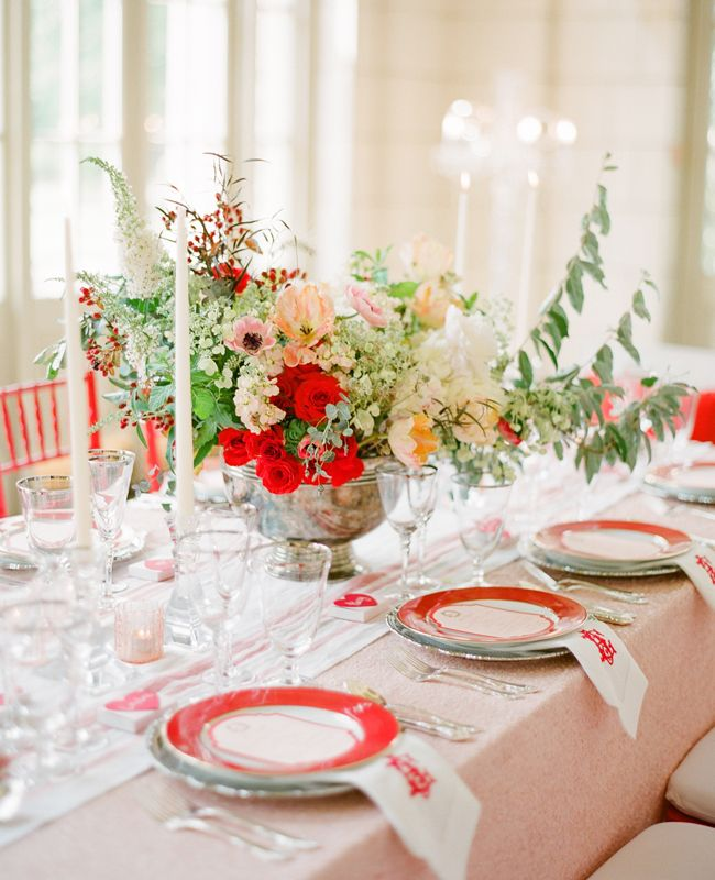 red floral arrangement and table setting by Strawberry Milk Events