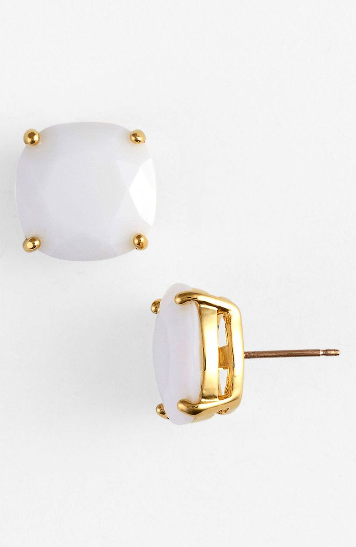 Oh so pretty white and gold Kate Spade earrings.