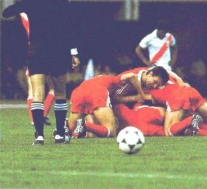 Group stage,Polish group-hug and dissapointed Peruvian player after yet another goal,Poland vs Peru 5-1