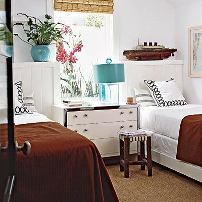 """""""These built-in twin beds make the best use of a tiny bedroom. A light palette and minimal pattern keeps the small space feeling airy."""" —Amy Mitchell, managing editor"""